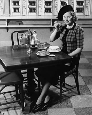 Woman In Fancy Hat Eating Breakfast In Bar, (b&w), Portrait Art Print by George Marks