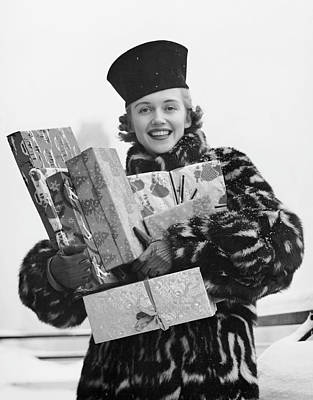 Woman In Fur Coat Holding Christmas Gifts Art Print by George Marks