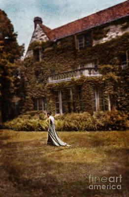 Woman In Gown Walking Outside A Mansion Art Print by Jill Battaglia