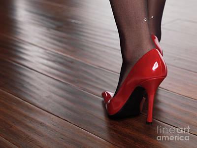 Woman In Red High Heels Walking On Hardwood Floor Art Print by Oleksiy Maksymenko