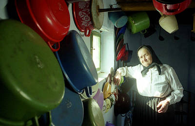 Photograph - Woman In The Kitchen In Maramures Romania by Emanuel Tanjala