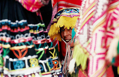 Woman In Traditional Hat Looking Through Textiles And Fabric Of Stall, Peru, South America Art Print by Richard I'Anson