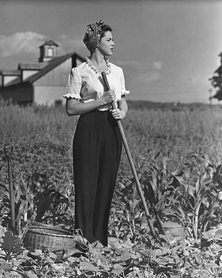 Woman In Vegetable Garden Art Print by George Marks