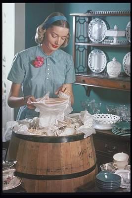 Woman Packs, Unpacks A Barrel With Dishes Art Print