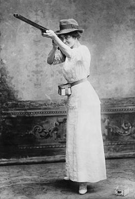 Woman Posed With Shotgun Art Print by Everett