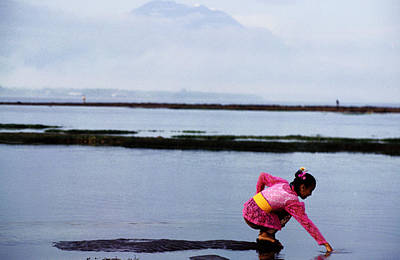 Woman Reaching Into Water With Gunug Agung In Background Print by Gregory Adams