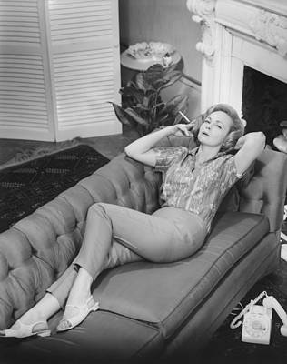Woman Relaxing On Sofa, (b&w), Elevated View Art Print by George Marks