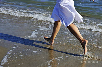 Wet On Wet Photograph - Woman Running In Water On Beach by Sami Sarkis