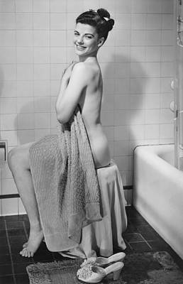 Domestic Bathroom Photograph - Woman Sitting In Bathroom, Covering Herself With Towel, (b&w), Portrait by George Marks