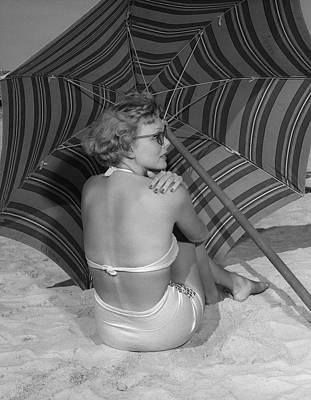 Woman Sitting On Beach Under Umbrella Art Print by George Marks