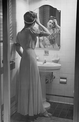 Woman Suffering Headache Standing In Front Of Bathroom Mirror, (b&w) Art Print by George Marks