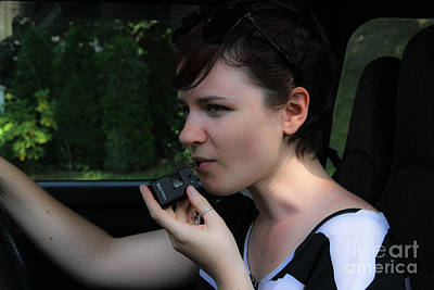 Drunk Driving Photograph - Woman Using A Breathalyzer by Photo Researchers, Inc.
