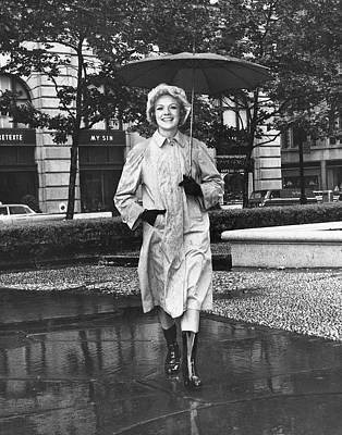 Woman Walking In Rain Art Print by George Marks
