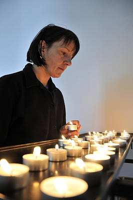 Photograph - Woman With Candles In Church by Matthias Hauser