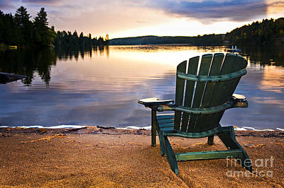 Cottage Chairs Photograph - Wooden Chair At Sunset On Beach by Elena Elisseeva