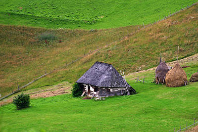 Photograph - Wooden Cottage And Haystacks by Emanuel Tanjala