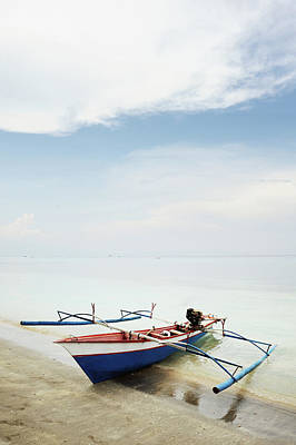 Wooden Outrigger Boat On Shore Art Print by Carlina Teteris