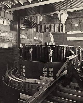 Workmen Installing A Generator Art Print by Everett