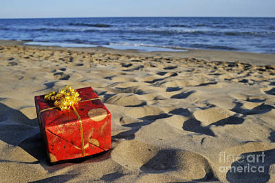 On Paper Photograph - Wrapped Gift Box On Beach by Sami Sarkis