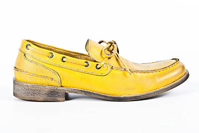 yellow Mens shoe Art Print by Chavalit Kamolthamanon