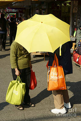 Photograph - Yellow Umbrella Vancouver Chinatown by John  Mitchell