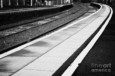 Yellow Warning Line And Textured Contoured Tiles Railway Station Platform And Track Northern Ireland Art Print by Joe Fox