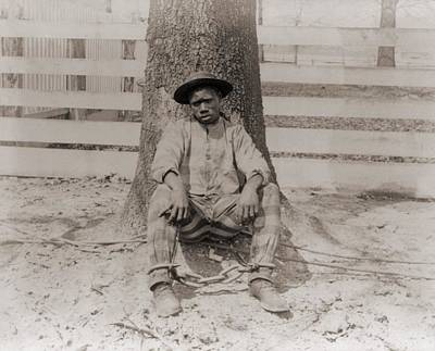 Jim Crow South Photograph - Young African American Sitting by Everett