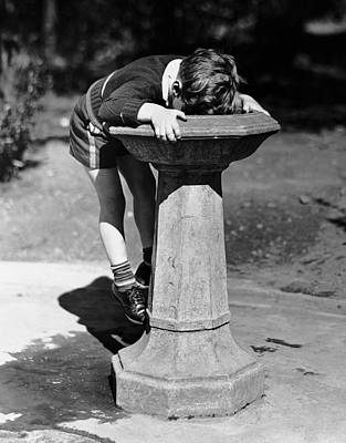 Young Boy Drinking From Water Fountain Art Print by George Marks