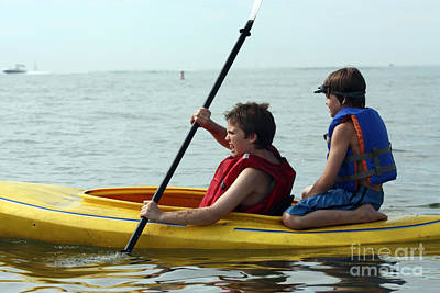 Young Boys Playing On A Kayak Art Print by Christopher Purcell