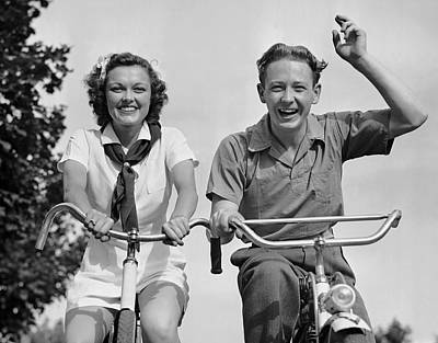 Young Couple Riding Bicycles Art Print by George Marks