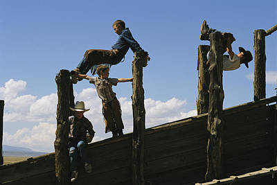 Cattle Chute Photograph - Young Cowboys Playing On A Cattle Chute by Melissa Farlow