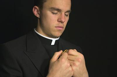 Vicars Close Photograph - Young Priest Praying With Rosery by Gregory Dean