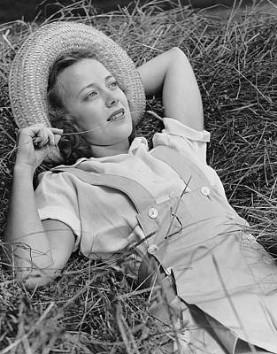 Young Woman Laying In Hay Thinking Art Print by George Marks