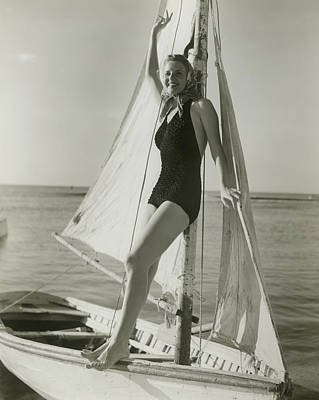 Young Woman Posing On Sailboat Art Print by George Marks