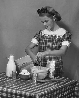 Young Woman Preparing Food Art Print by George Marks