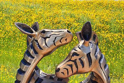 Zebra Sculptured Heads In Wildflowers Art Print by Linda Phelps
