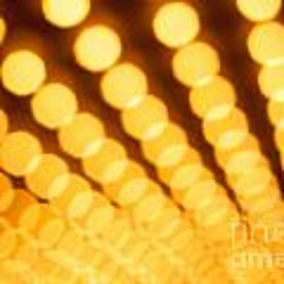 Theater Lights In Rows Defocused Art Print by Paul Velgos