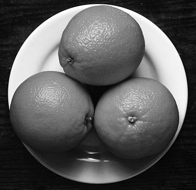 Tangy Photograph -  Oranges On White Plate In Black And White by Donald Erickson