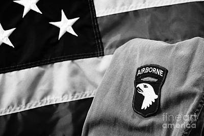 101st Photograph - 101st Airborne Division Screaming Eagles Patch On Vietnam Era Uniform In Front Of United States Of America Flag by Joe Fox