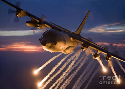 Shooting Wall Art - Photograph - A C-130 Hercules Releases Flares by HIGH-G Productions