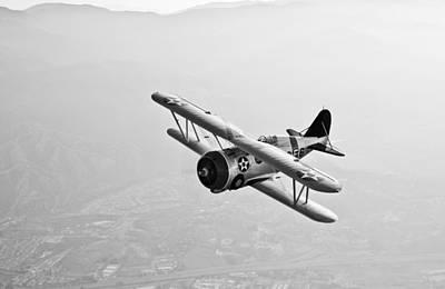 A Grumman F3f Biplane In Flight Print by Scott Germain