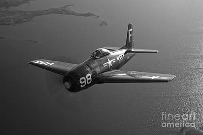 Photograph - A Grumman F8f Bearcat In Flight by Scott Germain