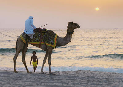 Little Boy Stares In Amazement At A Camel Riding On Marina Beach In Dubai, United Arab Emirates -  Art Print