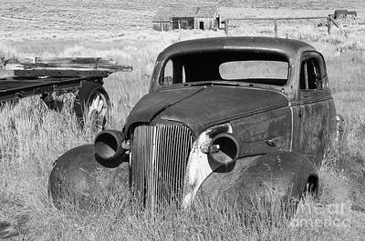 Abandoned Cars Photograph - A Ride To The Past by Sandra Bronstein