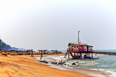 Photograph - a rusty colorful shipwreck projects out of the water of the Indian Ocean at the coast of Sri Lanka by Regina Koch