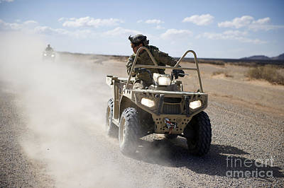 Two-wheeler Photograph - A U.s. Soldier Performs Off-road by Stocktrek Images