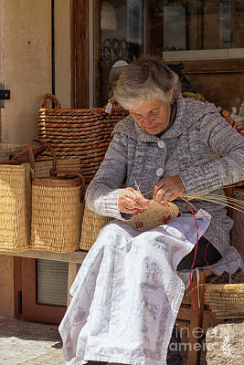 Photograph - A Woman Weaving A Basket In Castelsardo by Patricia Hofmeester