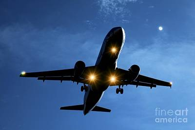 Moonlit Night Photograph - Airbus A320 Airliner Landing At Night by Detlev van Ravenswaay