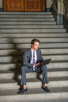 Photograph - American Businessman Working On Laptop, Sitting On Stairs by Alexander Image