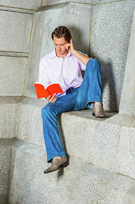 Photograph - American Man Reading Book, Talking On Cell Phone Outside by Alexander Image